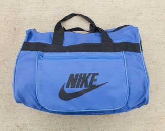 f4a705a9fbdb Vintage 90 s Nike Logo Swoosh Athletic Blue Nylon Duffel Overnight Gym Bag  Travel Carry On