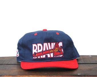 17eda4f1cea Vintage 90 s Atlanta Braves MLB Snapback Hat Baseball Cap