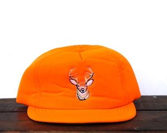 c7f6ea465daf3 Vintage 80 s Deer Head Buck Wildlife Neon Blaze Orange Hunting Warm Earflap  Winchester Rifles Ammo Trucker Hat Snapback Baseball Cap