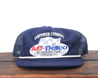 b1f316f23eb Vintage Trucker Hat Snapback Hat Baseball Cap AC Delco Powers The Winners  Spark Plugs Auto Parts Racing