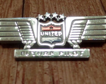 "c7a94a8c8 UNITED Future Pilot Pin, Stoffel Seals. Made with silver plastic. Approx. 3""  wide"