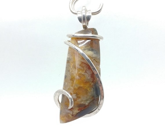 Orange Red & Blue Widowmaker Plume Agate Pendant in Hammered Sterling Silver