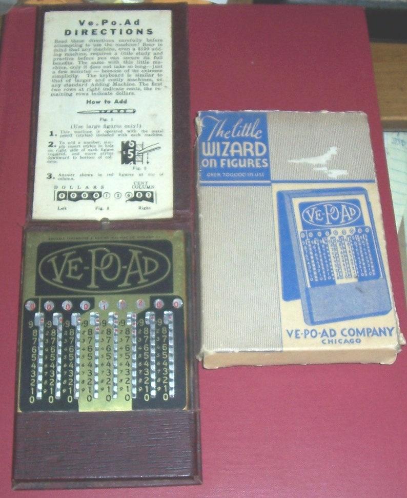 Vintage Little Wizard vest-pocket manual calculator, in box