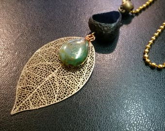 Long necklace, gold openwork leaf and picasso glass beads