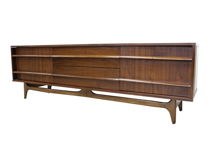 Mid-Century Modern Concave Front Low Walnut Credenza by Young Mfg. Co.