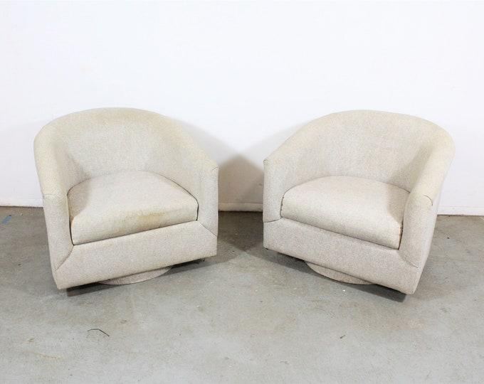 Pair of Mid-Century Modern Swivel Club Chairs on Platform base