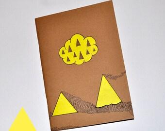 Customized in yellow, Moleskine notebook.