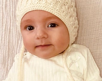 A beautiful hand knitted vintage style baby bonnet for Spring  for newborn and children up to the age of 3. Would make ideal  shower gift.