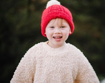 Hand knitted Child's knitted cabled slouchy hat. Available for babies and children from newborn to 7 years old