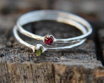 A rose by any other name 2 ring set, sterling silver hammered stacking rings with 2mm garnet and peridot.