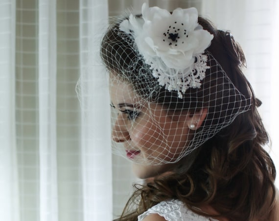 Bridal birdcage veil with a lace and feathers fascinator for Wedding and Tea Party
