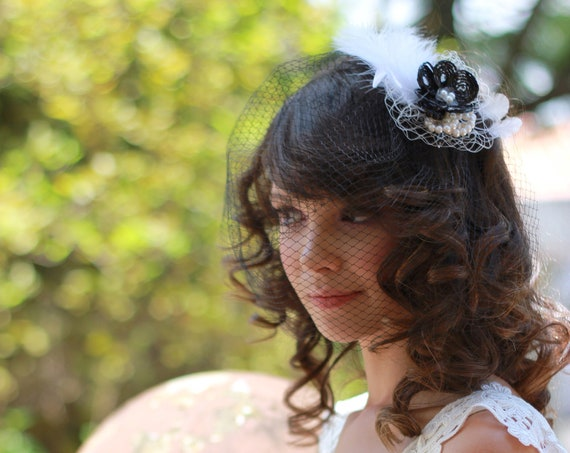Vintage style birdcage veil with a Black and White fascinator