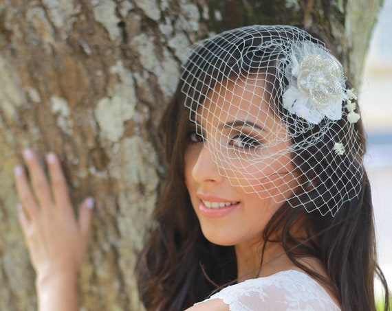 Mini birdcage veil with a floral hair accessory clip