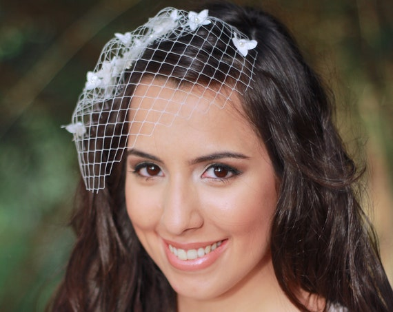 Mini birdcage veil with tiny flowers and pearls