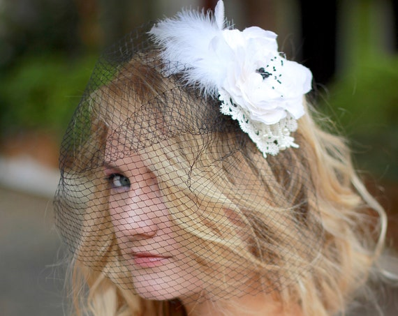 Delicate lace and feathers fascinator with birdcage veil