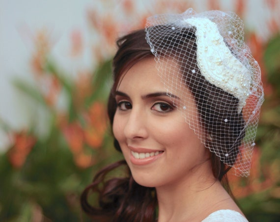 Fashionable birdcage veil with a 1950s style bridal cap headpiece Juliet cap inspired