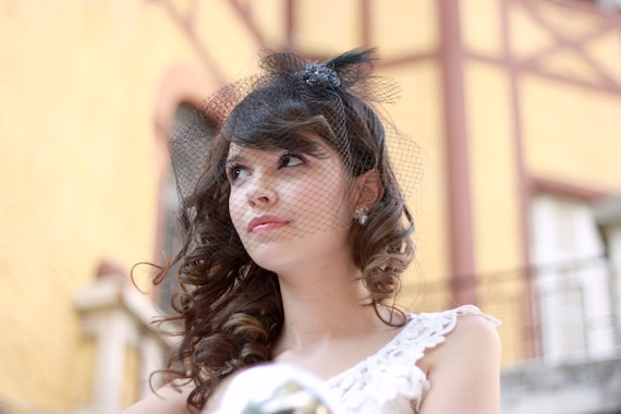 Small bow fascinator with birdcage veil for brides, mother-of-the bride and guests