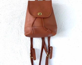b2839bc95f996 Vintage Coach 90s Backpack Black Brown Leather Turnlock mini daypack