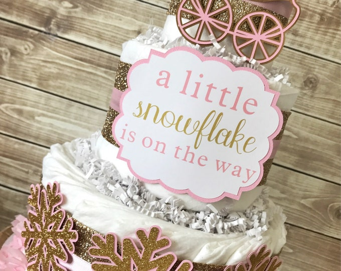 Featured listing image: A Little Snowflake is on the Way Diaper Cake, Winter Baby Shower Centerpiece in Pink and Gold