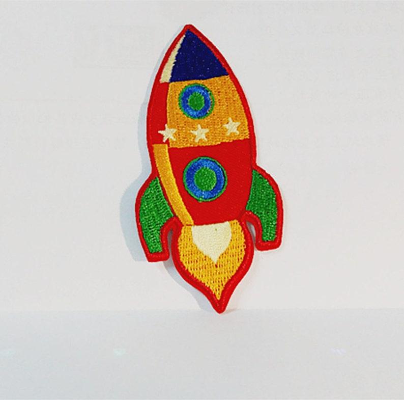 0760c0e6d Dibujos animados de colores Jet avión cohete 4 x 8.5 cm