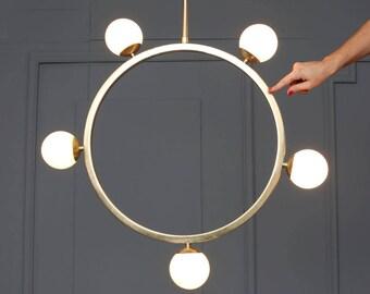 SAINT Handmade Pendant Light minimal geometric sculptural globe opal