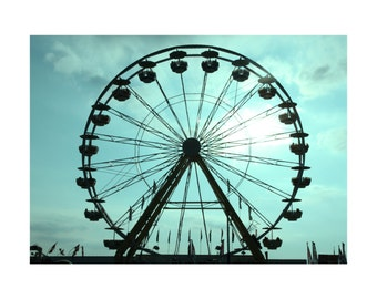 Farris wheel, in teal, silhouette, sunset.