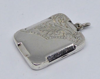 Sterling silver Art Deco rectangular shaped locket with partial engraving
