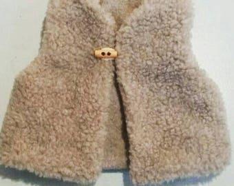 Grey bobble waistcoat.