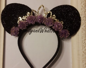 Black Sparkly Minnie Mouse Ears with Gold Tiara and purple organza flowers trimmed in gold.
