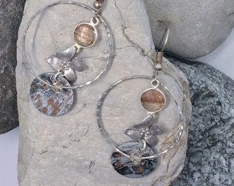 copper patina hoop earrings. surrounded by hammered wire and embellished with swarovski crystals