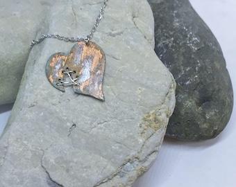 Copper patina stitched heart pendant