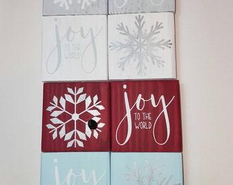 "Holiday mini signs. Joy to the world. Snowflakes. Mini christmas signs. 3.5 x 3.5"" red, white, gray, light blue. Mini snowflakes."