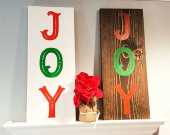 JOY red and green christmas decorative sign. White or wood stain back. JOY painted in red and green painted on white or wood stain.
