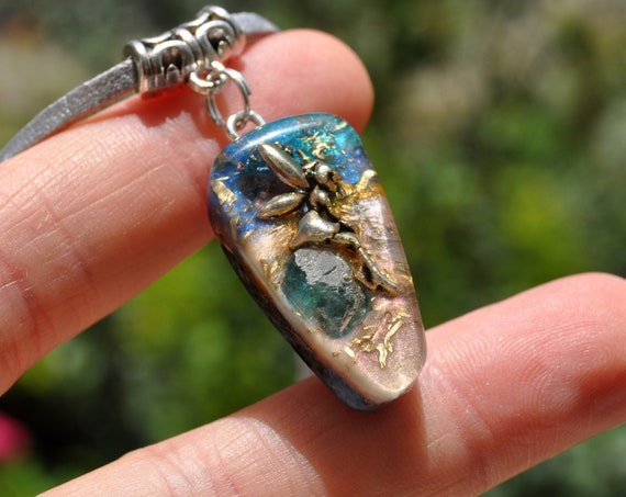 Fairy sitting on blue Apatite Orgonite® Pendant Necklace