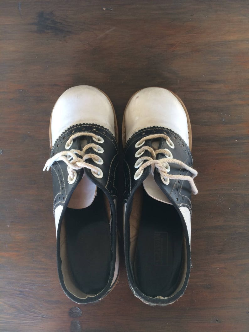 dad513284daa9 Classic Black & White Saddle Shoes with Red Rubber Soles with a Heel