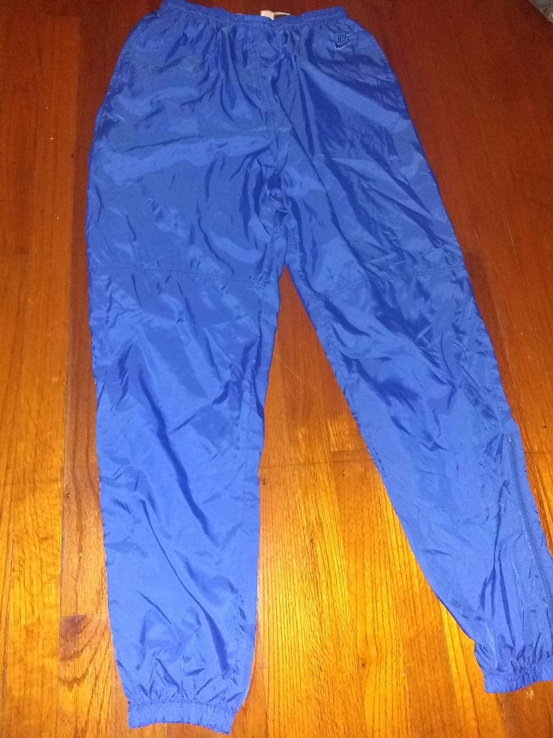 0ca9acd5afa0 Vintage Nike windbreaker pants Royal Blue Size XL