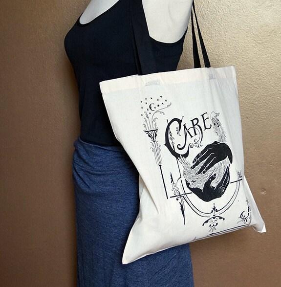 "Tote bag ""Care,"" black on natural white"