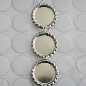 You choose from silver or colored No liners The split rings are already attached to save you time 50 Regular Bottle Caps WITH SPLIT RING