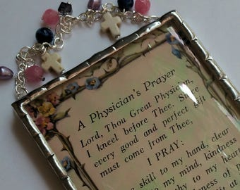 A Physician's Prayer plaque soldered in iridescent water glass with howlite crosses, pink quartz, freshwater pearls and agate beads