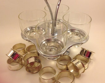 midcentury stainless steel glass and wood spinning condiment server carrier with handle  Bonus:  set of 12 silver plate napkin rings