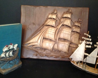 vintage ship schooner boat & sails wall art and pair of bookends of plaster/chalkware