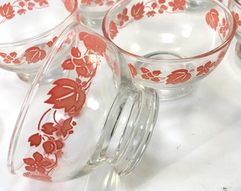 set of 7 small midcen clear glass footed ice cream fruit dessert bowls with Salmon pink floral motif pattern decoration