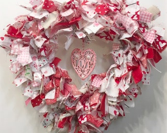 "Valentine's rag wreath heart shaped w/woodcut 'Love' on 12"" wide metal form"