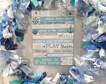 "rag wreath fabric and ribbon coastal beach nautical summer blue and white theme round 14"" metal ring MDF sign 'Beach Rules' hangs in center"