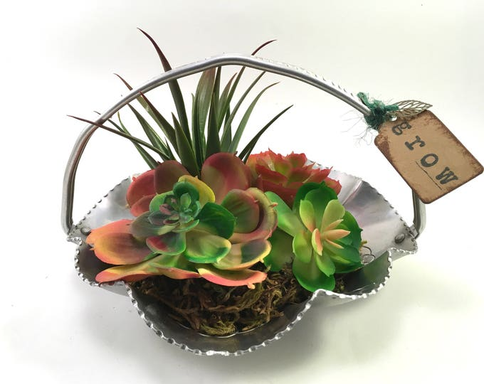Featured listing image: Faux succulent plant arrangement in mid-century scalloped aluminum basket labeled 'grow' with leaf charm