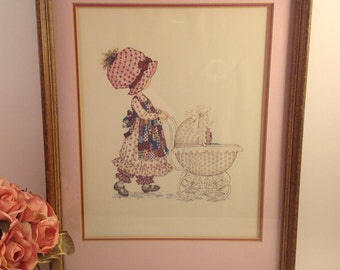 Vintage Holly Hobbie wood framed l970's print pushes doll baby carriage double matted in pink