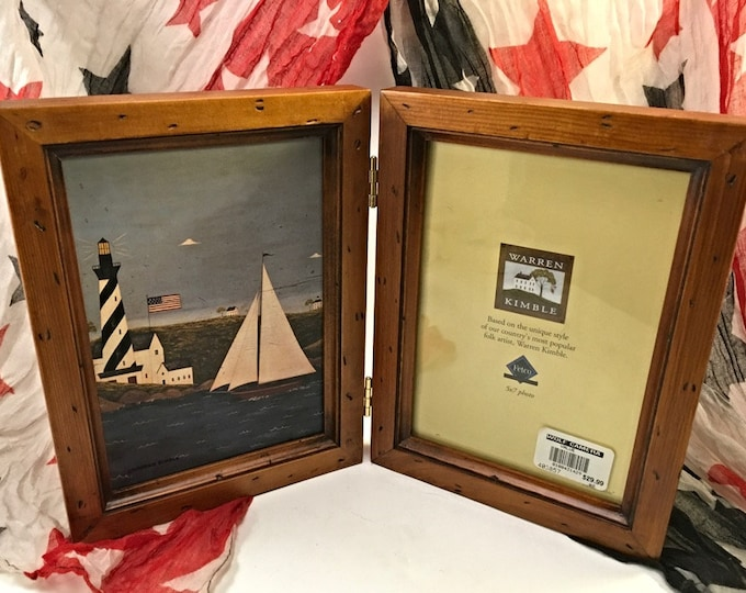 Featured listing image: Warren Kimble folk art Americana vintage country 5 x 7 double photo frame nautical sailboat and lighthouse at coast distressed wood