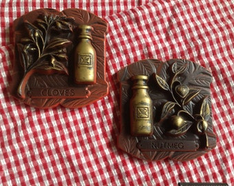 Pair of l976 Miller Studio Inc. chalk ware kitchen wall hanging sculptural plaques cloves & nutmeg