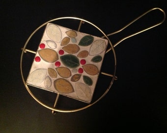 ceramic mosaic and brass trivet hot pad with leaves