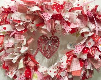 "Valentine's rag wreath heart shaped w/woodcut 'Love' 12"" wide metal form"